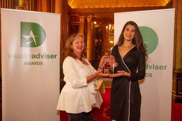 Wealth Dynamix team member collecting award