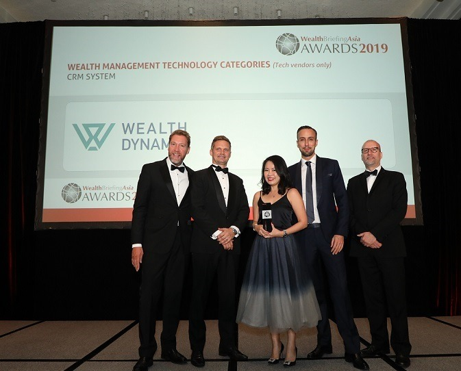 Wealth Dynamix Team collecting award for WealthBriefingAsia Awards 2019